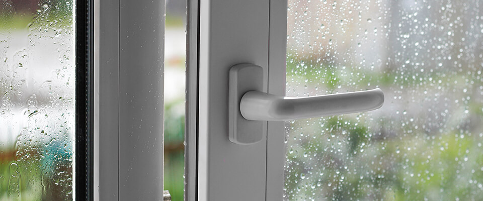 Rain drops on open PVC window