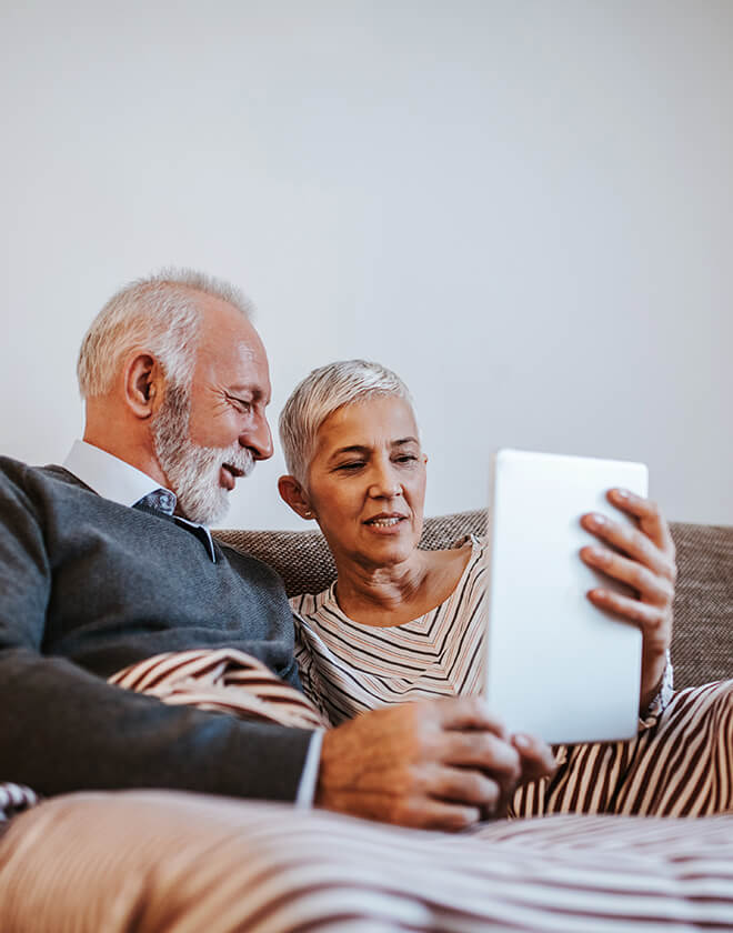 Eldery couple using tablet